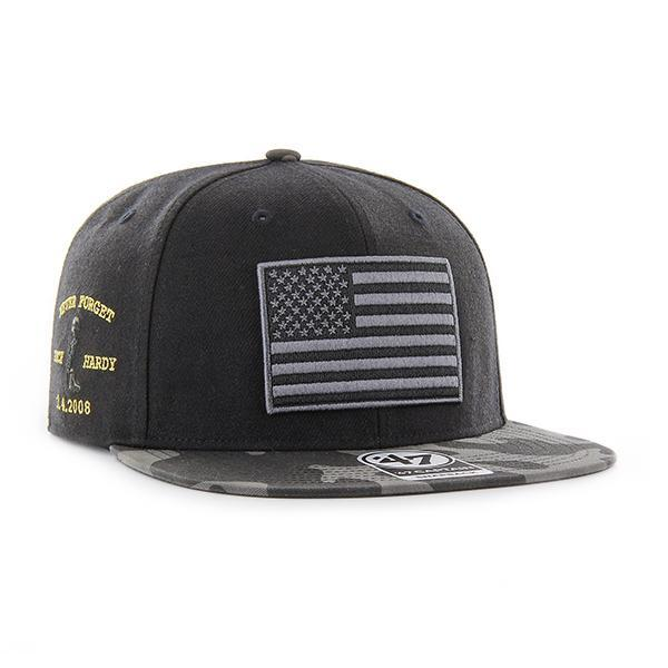 7745c5004ac The black on black camouflage operation hat trick snapback hat features a  black and gray USA
