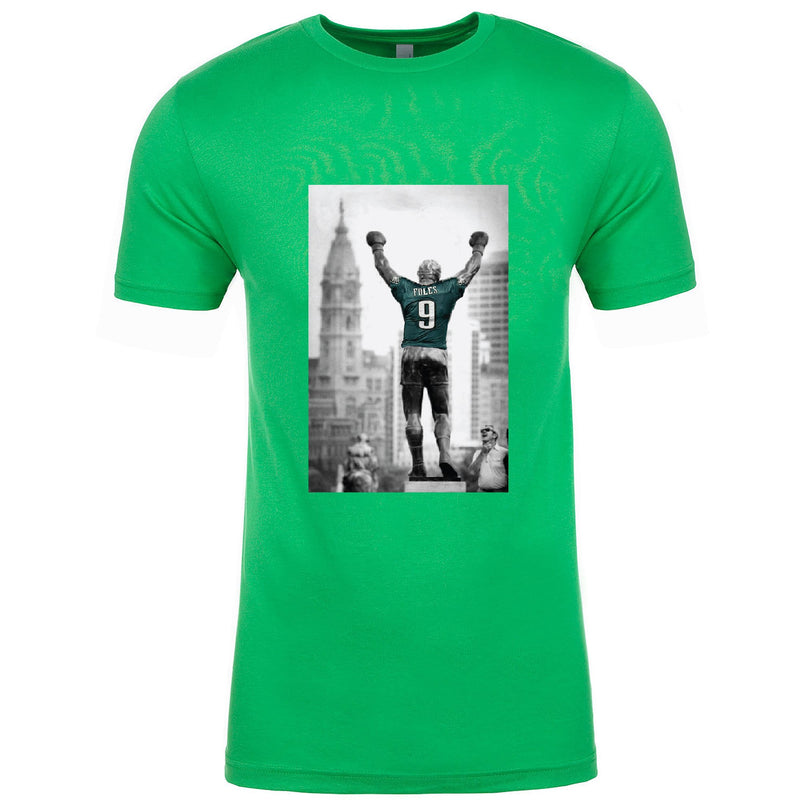 on the front of the nick foles rocky statue philadelphia eagles kelly green t-shirt is a black and white photograph of the rocky statue wearing a nick foles jersey