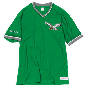 The kelly green retro v-neck t-shirt is solid kelly green with gray and white accents. The left chest features the throwback Philadelphia Eagles logo and the retro Eagles wordmark on the sleeve