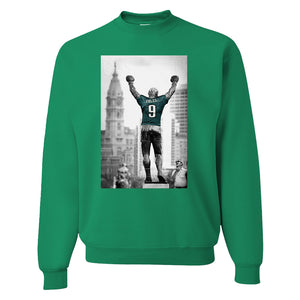 Rocky Foles Crewneck Sweatshirt | Rocky Statue Nick Foles Kelly Green Crew Neck Sweatshirt the front of this crew neck has the rocky foles statue