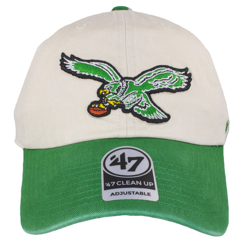 on the front of the cream on kelly green vintage logo dad hat is the philadelphia eagles retro logo embroidered in kelly green, white, yellow, brown, and black