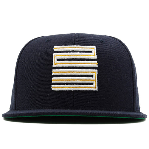 the dunk from above jordan 4 matching snapback hat is navy blue with a yellow and white logo on the front