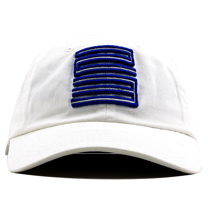 the white french blue jordan 12 matching 23 ball cap dad hat is solid white and has white and blue 23 jordan logo embroidered on the front