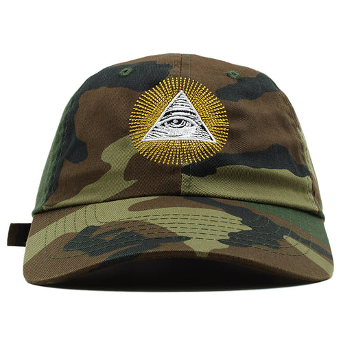 The All Seeing Eye Illuminati dad hat features the Illuminati pyramid embroidered on the front in white and black with rays surrounding it, embroidered in metallic gold thread.