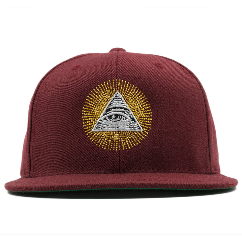 On the front of the All Seeing Eye Illuminati Maroon snapback hat is the illuminati pyramid embroidered in white and black