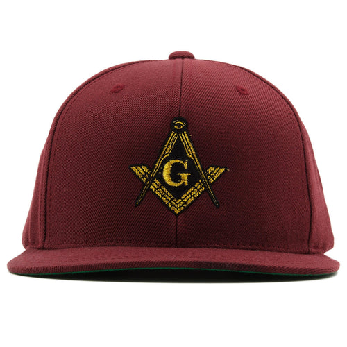 the masonic illuminati snapback hat is maroon has a gold and black logo