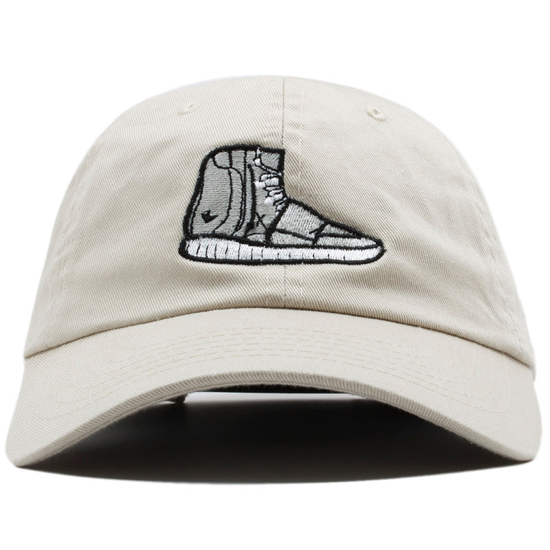 the khaki yeezy 750 boost dad hat is light khaki with a grey 750 boost sneaker embroidered on the front