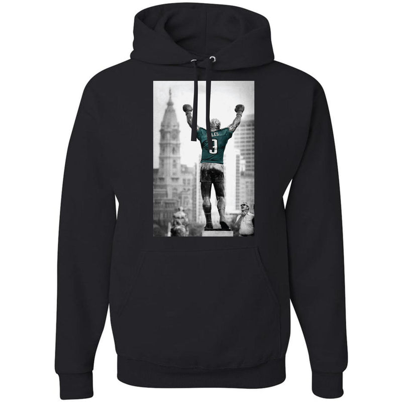 on the front of the black rocky statue nick foles jersey philadelphia eagles pullover black hoodie is a black and white photograph of the rocky statue with a nick foles jersey in pacific green