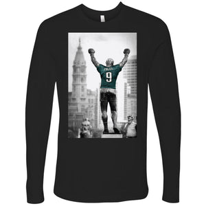 on the front of the black longsleeve rocky statue nick foles jersey t-shirt is a black and white photograph of the rocky statue wearing the nick foles jersey