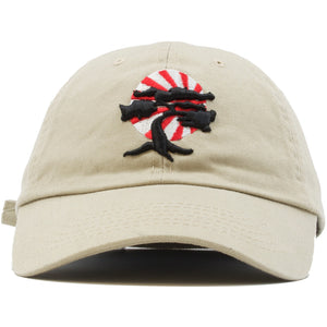 Foot Clan Bonsai Tree Dad Hat is khaki with a black bonsai tree on the front with a red and white Japanese rising sun behind the bonsai tree.