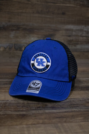 On the front of the Kentucky Wildcats Mesh Back dad hat is a circular patch with the University of Kentucky logo and the words Kentucky Wildcats