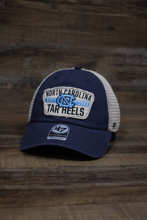 "on the front of the North Carolina Tar Heels mesh back dad hat is a distressed vintage patch with the NC logo, ""Established 1789"", and ""North Carolina Tar Heels"" embroidered on it"