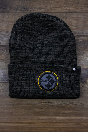 On the front of the Pittsburgh Steelers Brain Freeze beanie is an embroidered all black Steelers logo with a yellow outline