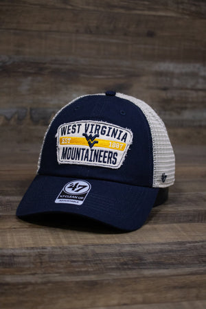 "On the front of the West Virginia Mountaineers mesh back dad hat is a distressed vintage patch with a navy blue WV logo, ""Established 1867"", and ""West Virginia Mountaineers"" embroidered on it"