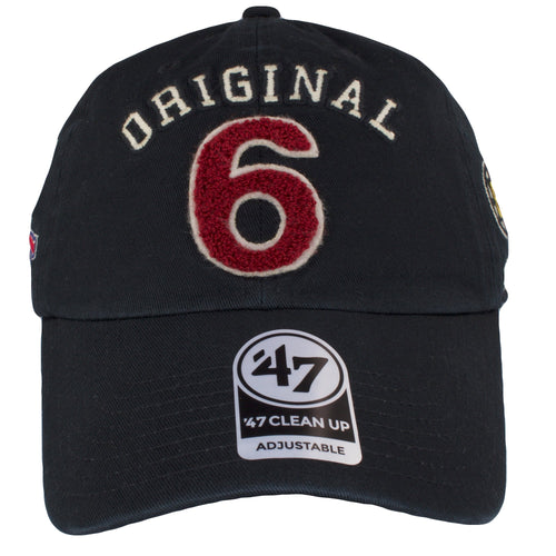 on the front of the black original six dad hat is the original 6 lettering in white and red
