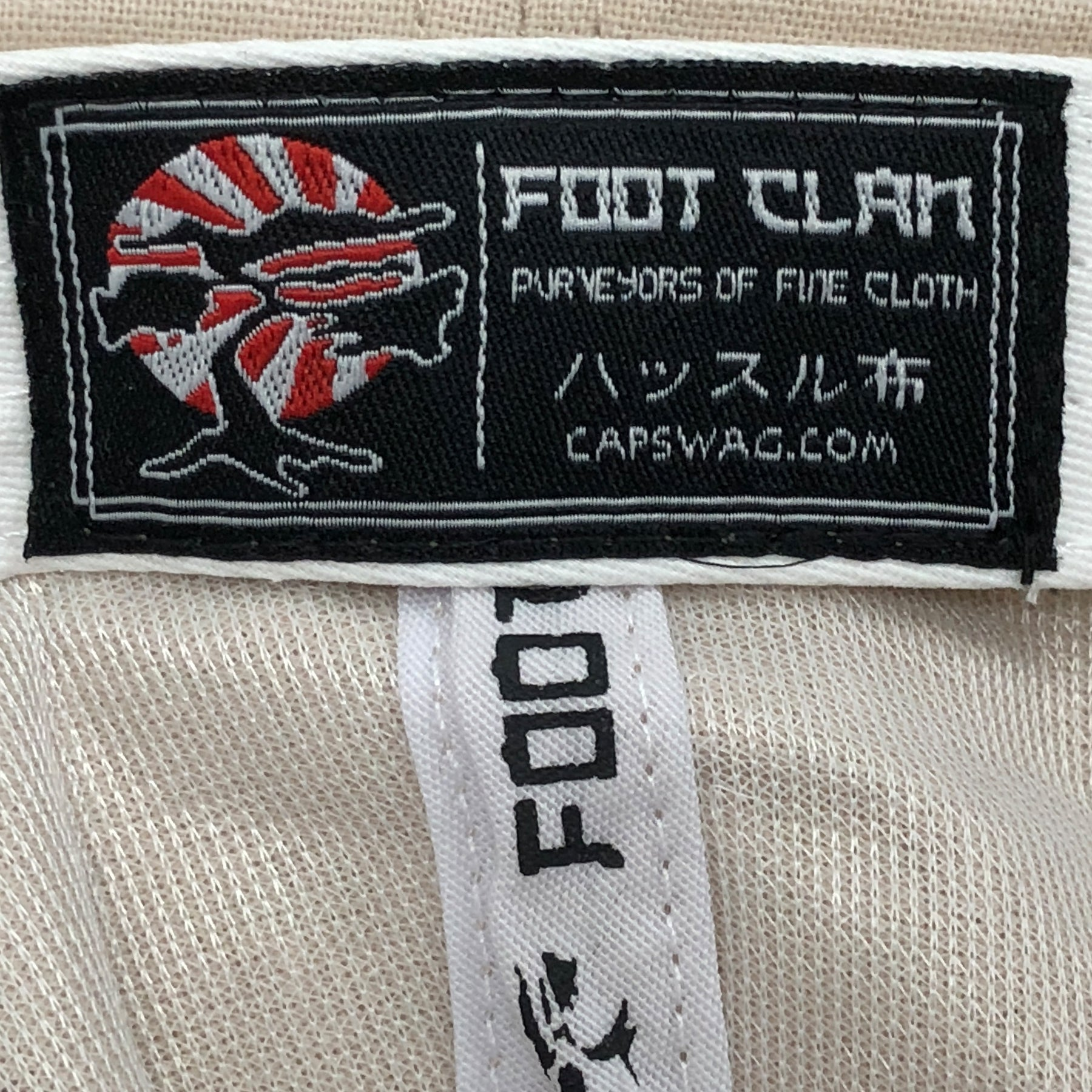 34ef085a981 ... The khaki linen blank adjustable ball cap has a label featuring the  Foot Clan Rising Sun  The internal metal ...