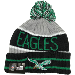 The front of the raised cuff on the Philadelphia Eagles Throwback Banner Winter Beanie features two kelly green stripes and the Philadelphia Eagles throwback logo embroidered in kelly green, white, black, brown, and yellow