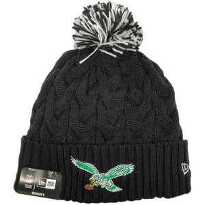Embroidered on the front of the Women's black thick knit throwback Philadelphia Eagles beanie is the vintage Philadelphia Eagles logo embroidered in kelly green, white, brown, yellow, and black