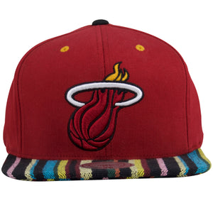 on the front of the miami heat baja poncho snapback hat is a miami heat logo embroidered in red, black, white, and yellow