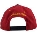 on the back of the miami heat baja poncho snapback hat is a yellow mitchell and ness logo embroidered above a black adjustable snap