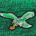 The Philadelphia Eagles kelly green throwback logo embroidered on the front of the raised cuff beanie is kelly green, white, black, yellow, and brown