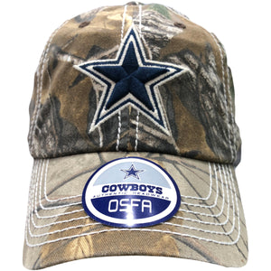 Embroidered on the front Dallas Cowboys realtree adjustable baseball cap is the Dallas Cowboys logo embroidered in navy blue and white