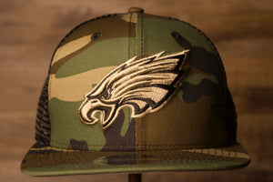 Eagles Snapback Trucker Hat | Philadelphia Eagles Tonal brown logo camouflage meshback snap trucker cap | OSFM the front of this eagles snap back hat is the eagles logo with a camo color hat