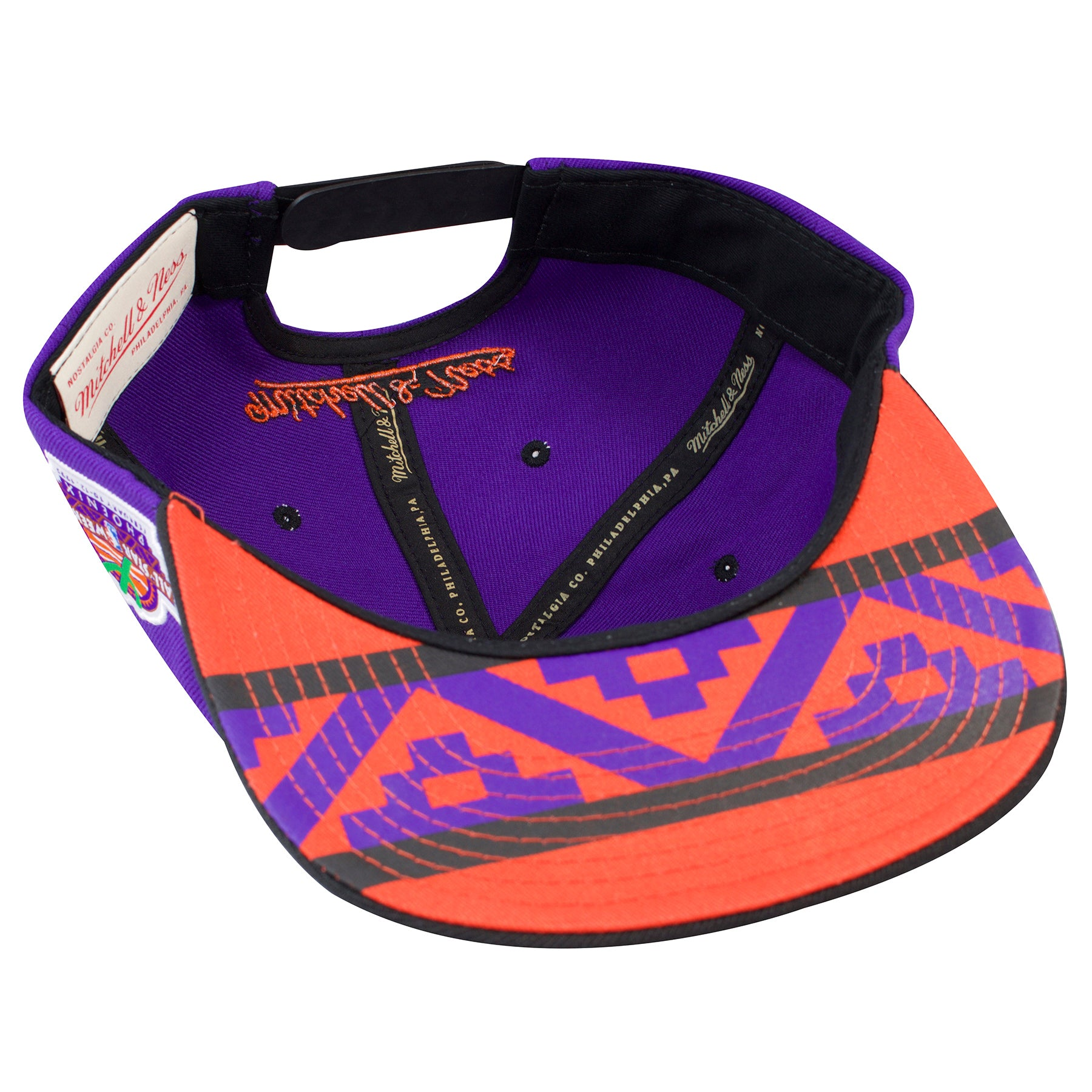 new arrival cf01f 8c2e9 ... mitchell and ness · the under brim of the phoenix suns 1995 all star  weekend snapback hat is an orange