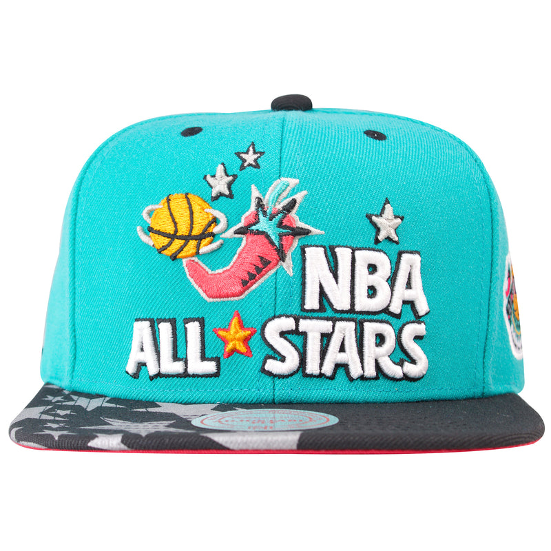 on the front of the vintage 1996 nba all star game snapback hat is the nba all stars lettering embroidered in white and black with the 96 nba all star logo embroidered in orange, black, silver, teal and pink