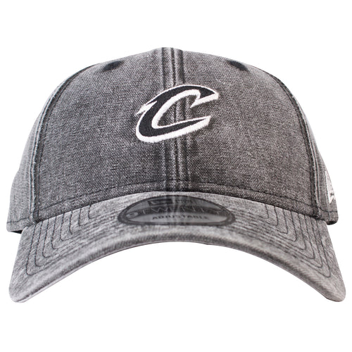 on the front of the cleveland cavaliers black denim 2018 all-star weekend dad hat is the cleveland cavaliers logo embroidered in black and white