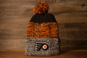 Flyers Beanie | Philadelphia Fyers Gray/Orange/Black Knit Beanie | OSFM the front of this beanie is black and orange with a grey cuff and the flyers logo on it