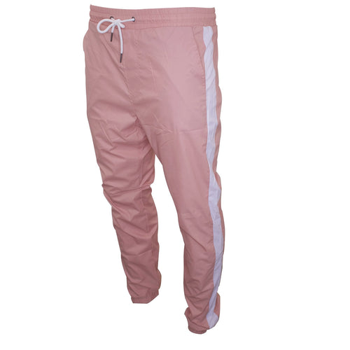 the pastel pink windbreaker track pants are pastel pink with white stripes going down the sides of the pant legs