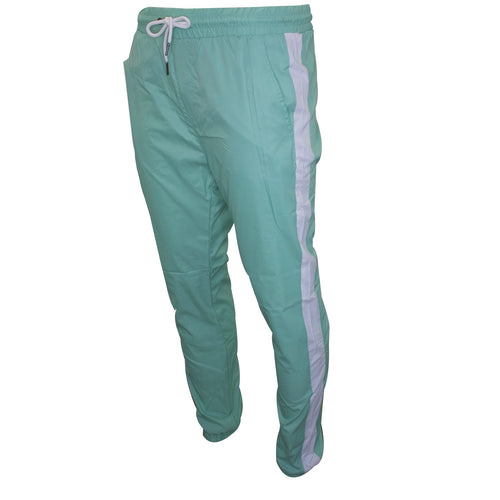 the pastel turquoise track pants have white stripes running down the sides of the track pants and have an adjustable waistband with a white string in the center