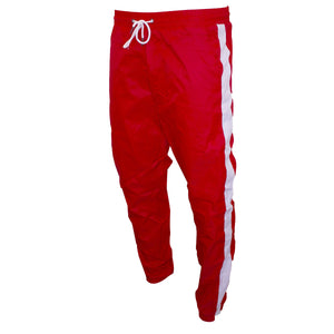 the red windbreaker track pants are solid red with a white string at the waist and white stripes down the pant legs
