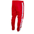 the bottoms of the pantlegs for the red windbreaker track pants are tapered with an elastic band