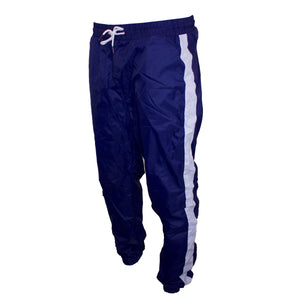 the navy blue windbreaker track pants are solid navy blue with white stripes going down the pantleg