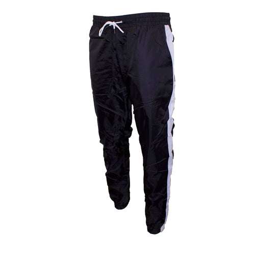 the black and white windbreaker track pants are black with white accents and white strings