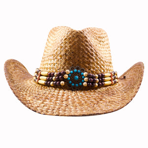 the front emblem of the bead emblem tan straw cowboy hat has a circular beaded aqua blue pattern