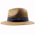 the brown straw fedora is woven in a circular fashion and has the iconic wide brim of a traditional fedora