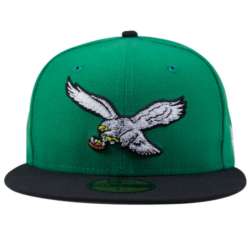 on the front of the kelly green on black throwback eagles fitted cap is the philadelphia eagles throwback logo embroidered in white, black, yellow and brown