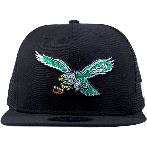 on the front of the philadelphia eagles vintage black trucker mesh snapback hat is the throwback eagles bird logo embroidered in kelly green, white, black, yellow and brown