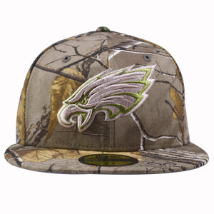The front of the Philadelphia Eagles Realtree Camouflage fitted cap has a light brown Philadelphia Eagles logo