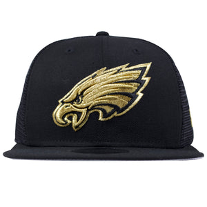 on the front of the philadelphia eagles champion gold snapback hat is the philadelphia eagles logo embroidered in gold and black