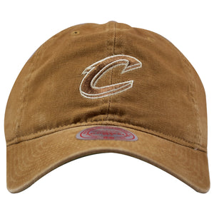 on the front of the cleveland cavaliers workman's utility cotton cleeland cavaliers dad hat is tan with a tan logo embroidered on the front