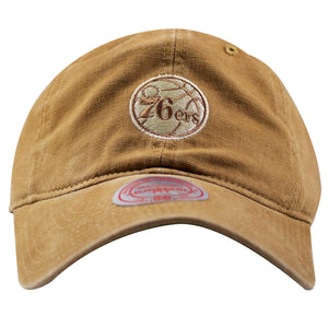 on the front of the philadelphia 76ers tan carhartt inspired dad hat is the philadelphia 76ers logo embroidered in tan