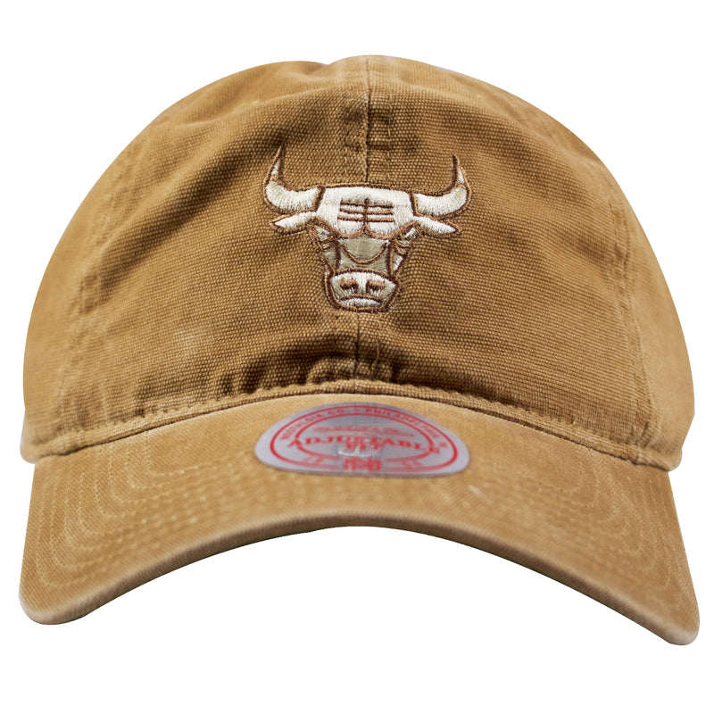 on the front of the chicago bulls tan workman carhartt inspired dad hat is the chicago bulls logo embroidered in a light color and tan