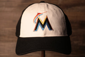 Marlins Dad Hat | Miami Marlins Retro Baseball Cap the front of this cap is white with the marlins logo on it