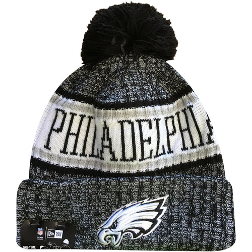 Embroidered on the front of the black and white Philadelphia Eagles On Field 2018 Sideline Cold Weather Winter Beanie is the Eagles logo embroidered in white and black
