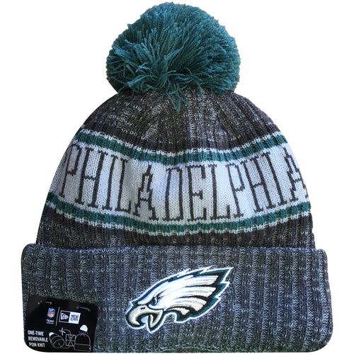 Embroidered on the front of the Philadelphia Eagles 2018 On Field Sideline Cold Weather Graphite Beanie is the Philadelphia Eagles logo embroidered in white, silver, black, and midnight green