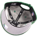 The under brim of the retro kelly green Philadelphia Eagles rugged dad hat is gray